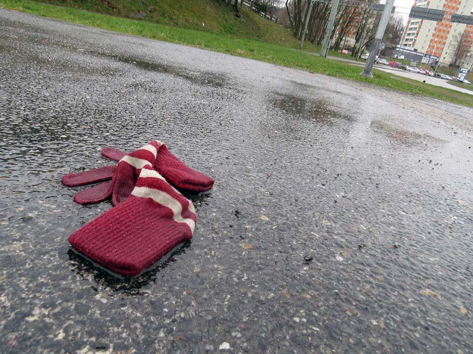 Striped gloves in the rain