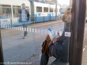 Reading in bus shelter